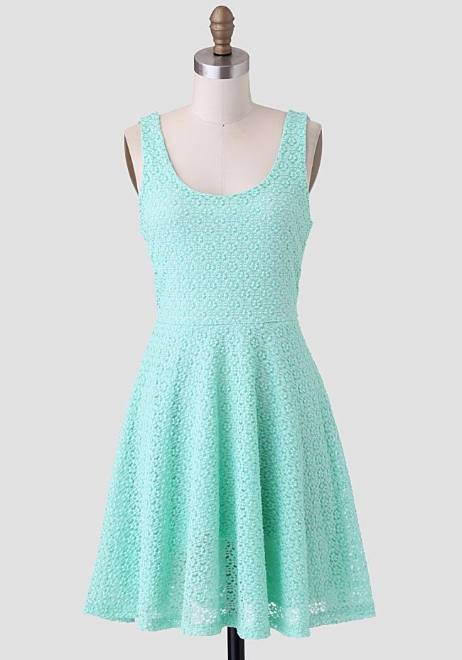 This lovely mint-hued dress features allover lace and is perfected with a skater silhouette. Finished with plenty of stretch, this Ruchette essential pairs well with sparkling accessories and nud...