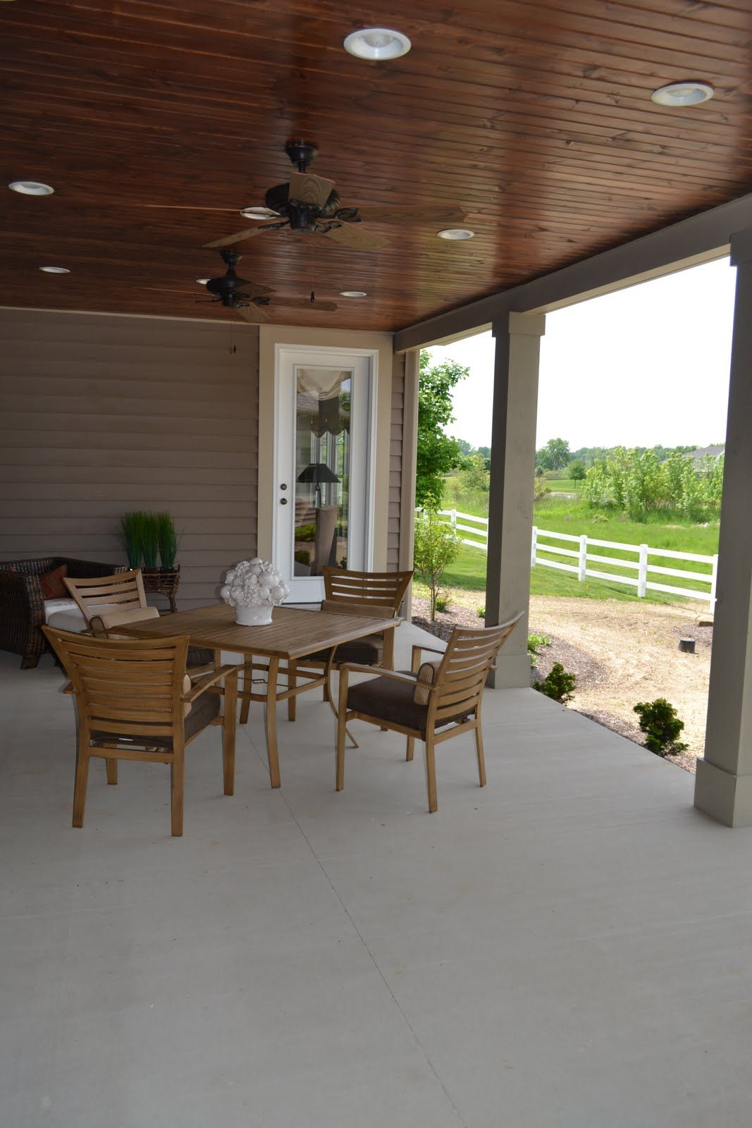 the porch that inspired our back porch. i love that it's covered