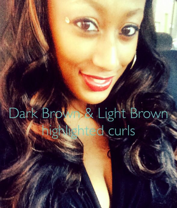 Mary Joyner in Black Hair with Dark Brown and Light Brown curled highlights.