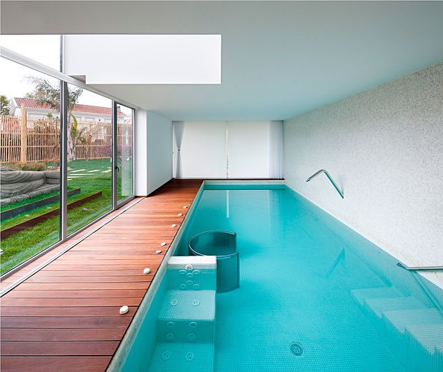 Huge house in Valongo by architect Carlos Nuno Lacerda Lopes 23 - pool mit glaswand garten