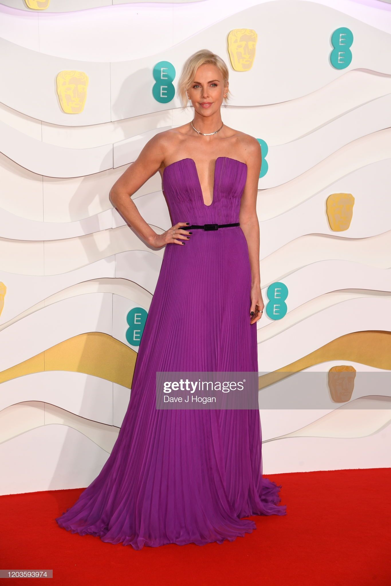 Charlize Theron Attends The Ee British Academy Film Awards 2020 At In 2020 Nice Dresses Purple Gowns Strapless Dress Formal