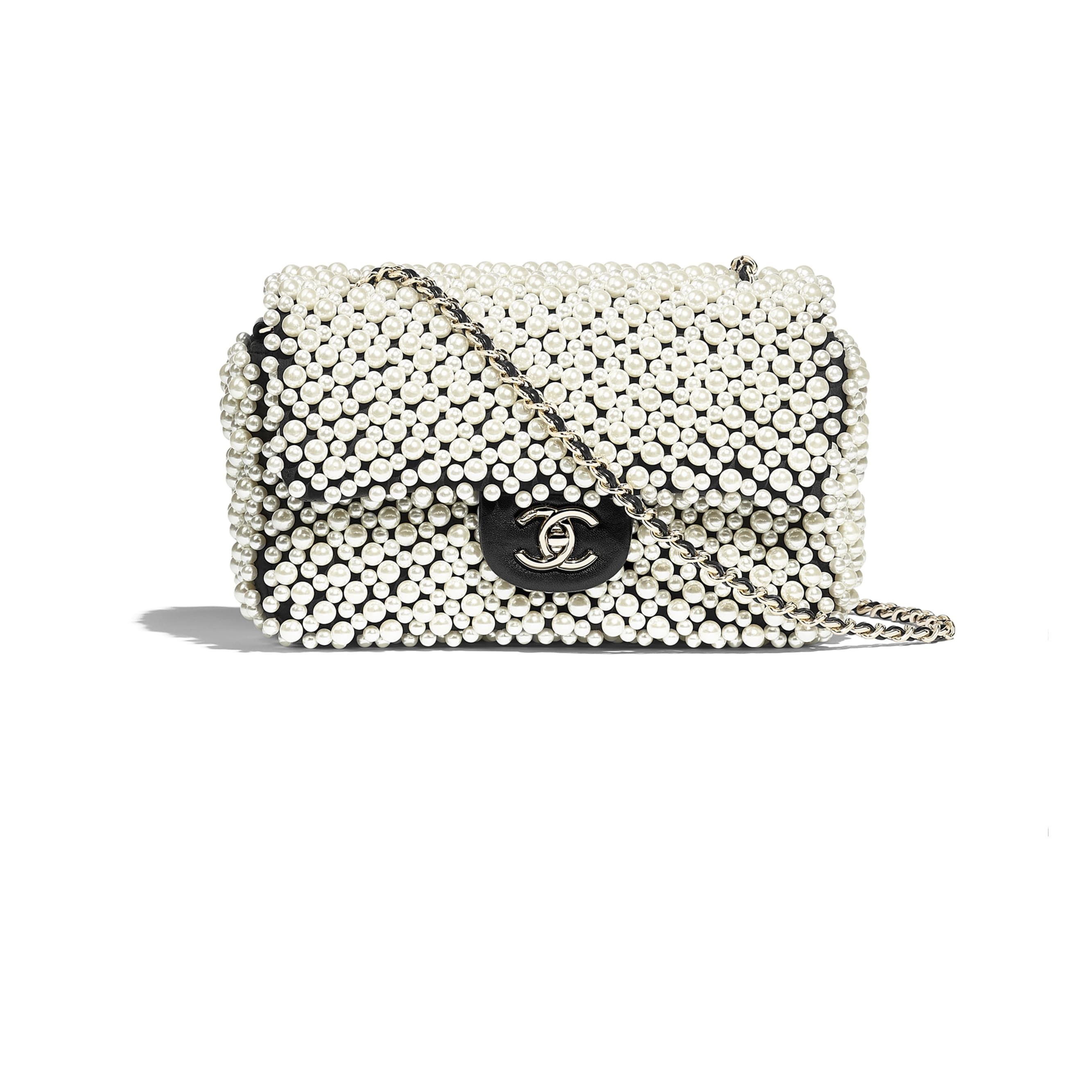 f8f52de1da5f Chanel - SS2019 | White & black imitation pearls, lambskin & gold-tone  metal flap bag ($4,900)