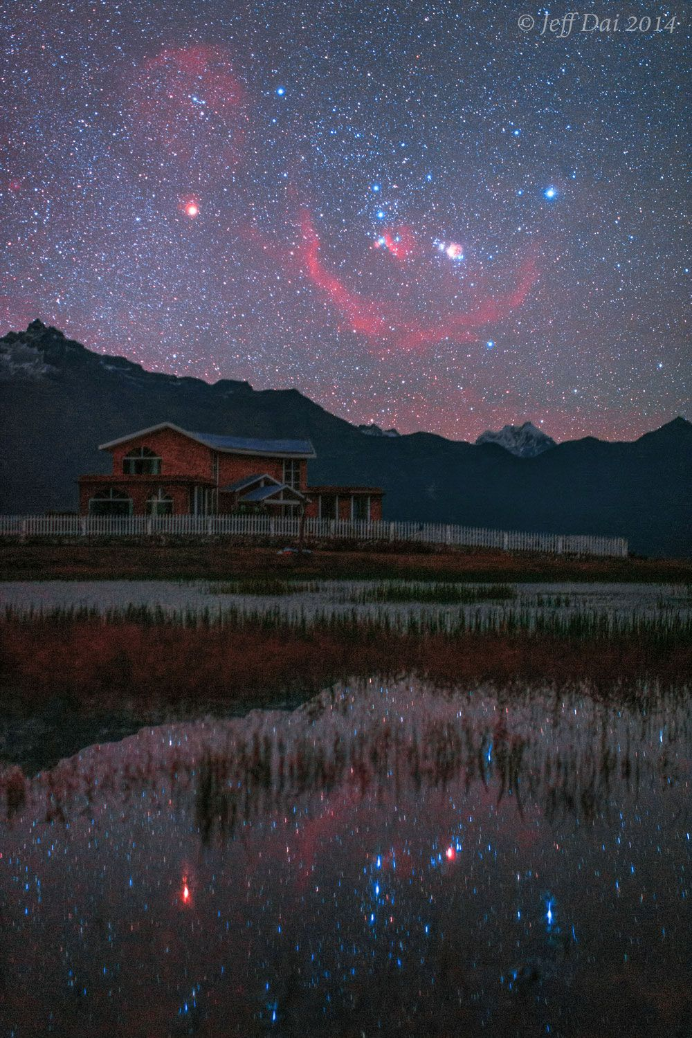 The famous constellation of Orion appears both above -- and reflected in -- a peaceful lake in the Gyirong Valley of Tibet, China. - Image Credit & Copyright: Jeff Dai