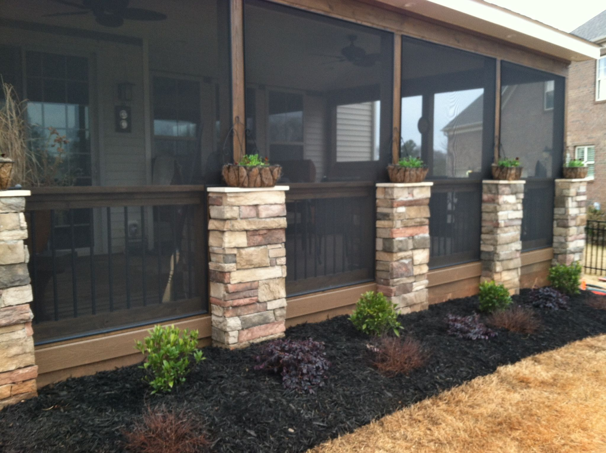 screen porch with stone veneer columns decorating my