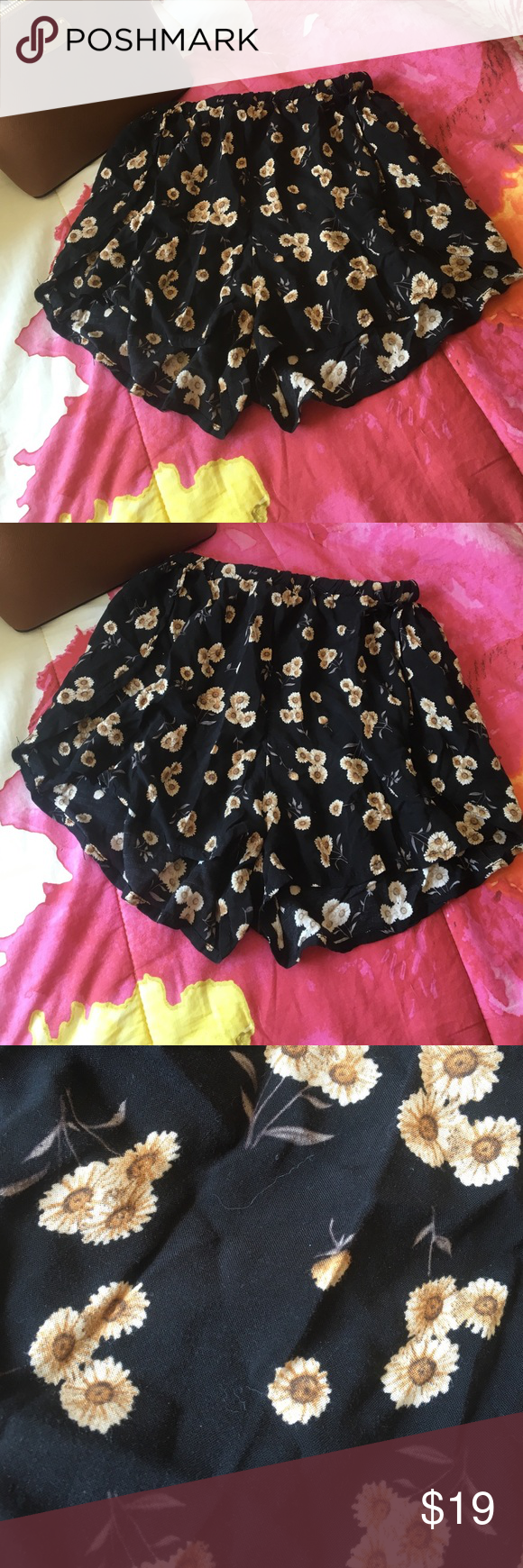 Brandy Melville flowy daisy shorts Super cute shorts from Brandy Melville! Great condition. Will sell on merc for cheaper just ask. Brandy Melville Shorts