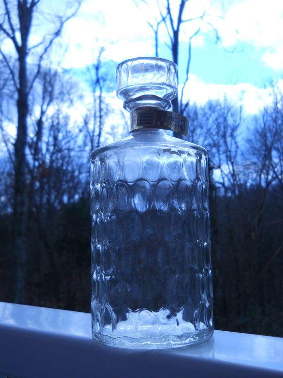 Vintage/Retro 1968 Kentucky Straight Bourbon Whiskey Empty Thumbprint Design Liquor Bottle with Matching Glass Stopper. $25.00, via Etsy.