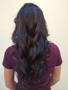 Long black hair with natural balayage to add dimension soft curls