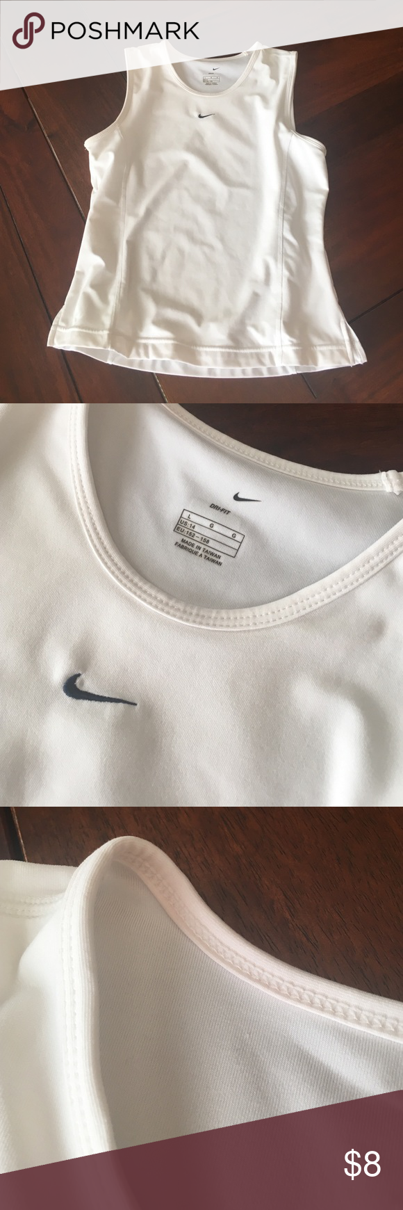 Junior's Nike Size L Workout Top White Dri-Fit Junior's Workout Top; Size L. Great condition, except when posting noticed a red tint (from red sports bra, perhaps) on upper right shoulder. Red tint on shoulder can be seen in third picture. Discounted appropriately. Nike Tops