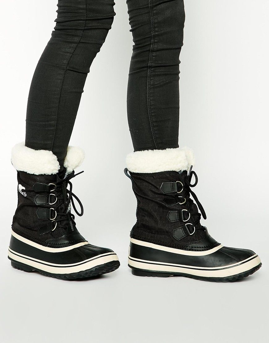 Sorel Winter Carnival Sherpa Snow Cuff Black Boots at asos.com