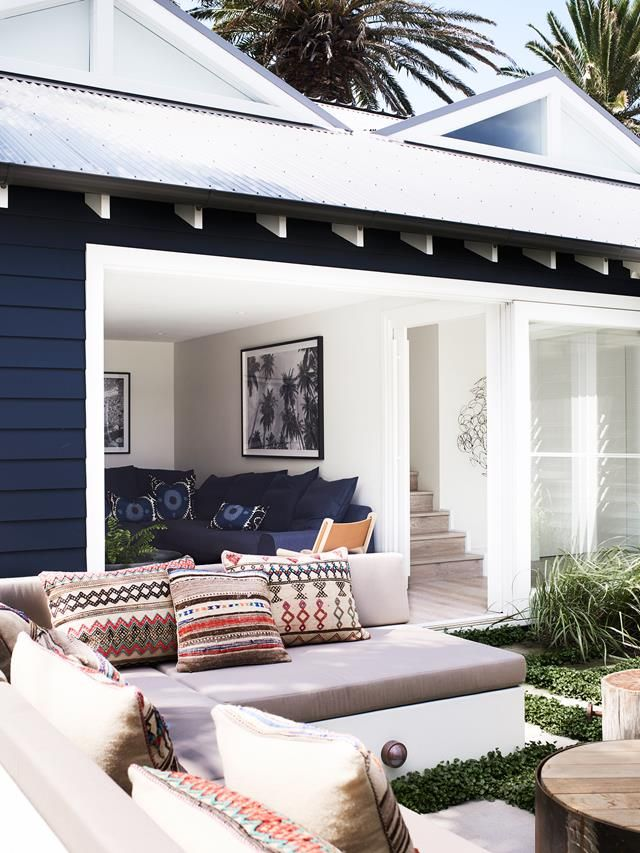 This luxurious coastal home on Sydney's Northern Beaches has sliding doors which open out onto the backyard's spacious sitting area, perfect for Summer entertaining. Photography: Prue Ruscoe | Styling: Amanda Mahoney | Story: Belle
