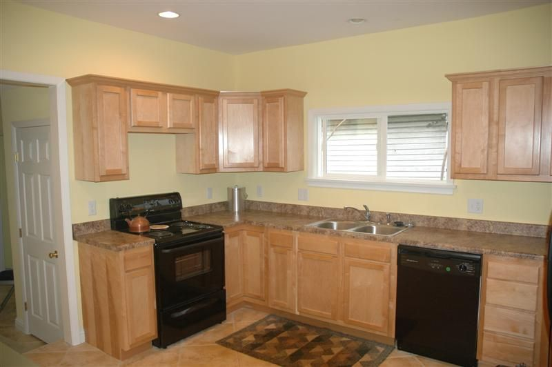 kitchen with oak cabinets with black appliances