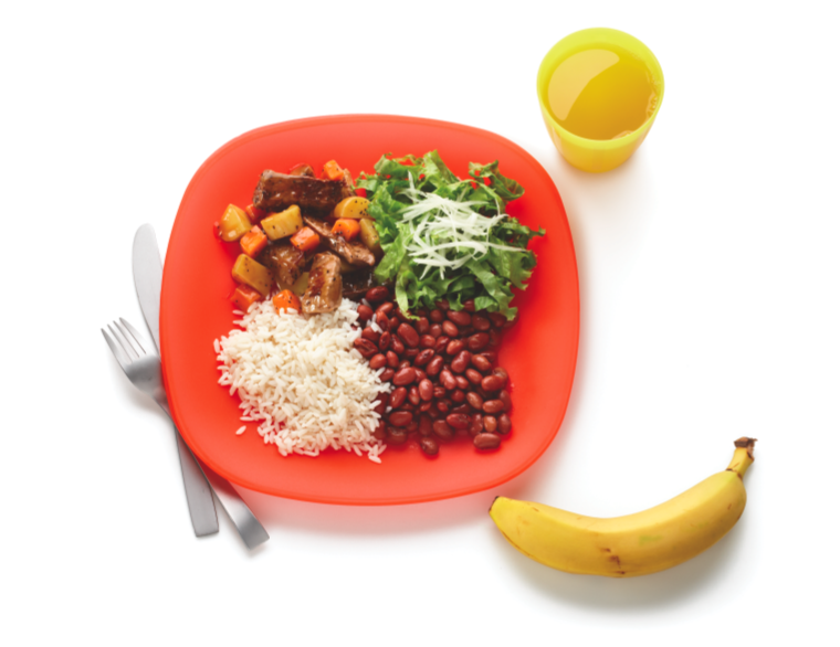 A typical school lunch in Brazil consists of beans, rice, acelga salad,  banana, and beef stew.