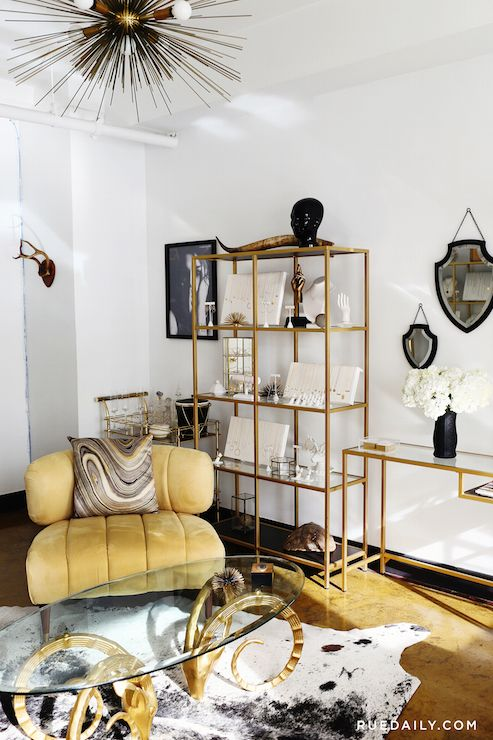 Zoe Chicco   Gold And Black Living Space Features A Gold Shelving Unit With Glass  Shelves, Ikea VITTSJÖ Shelving Unit, Filled With Jewelry Designed By Zoe ...