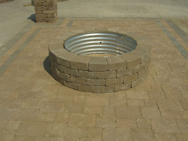 Diy fire pit 42 diameter metal fire ring and block units for What kind of bricks for fire pit