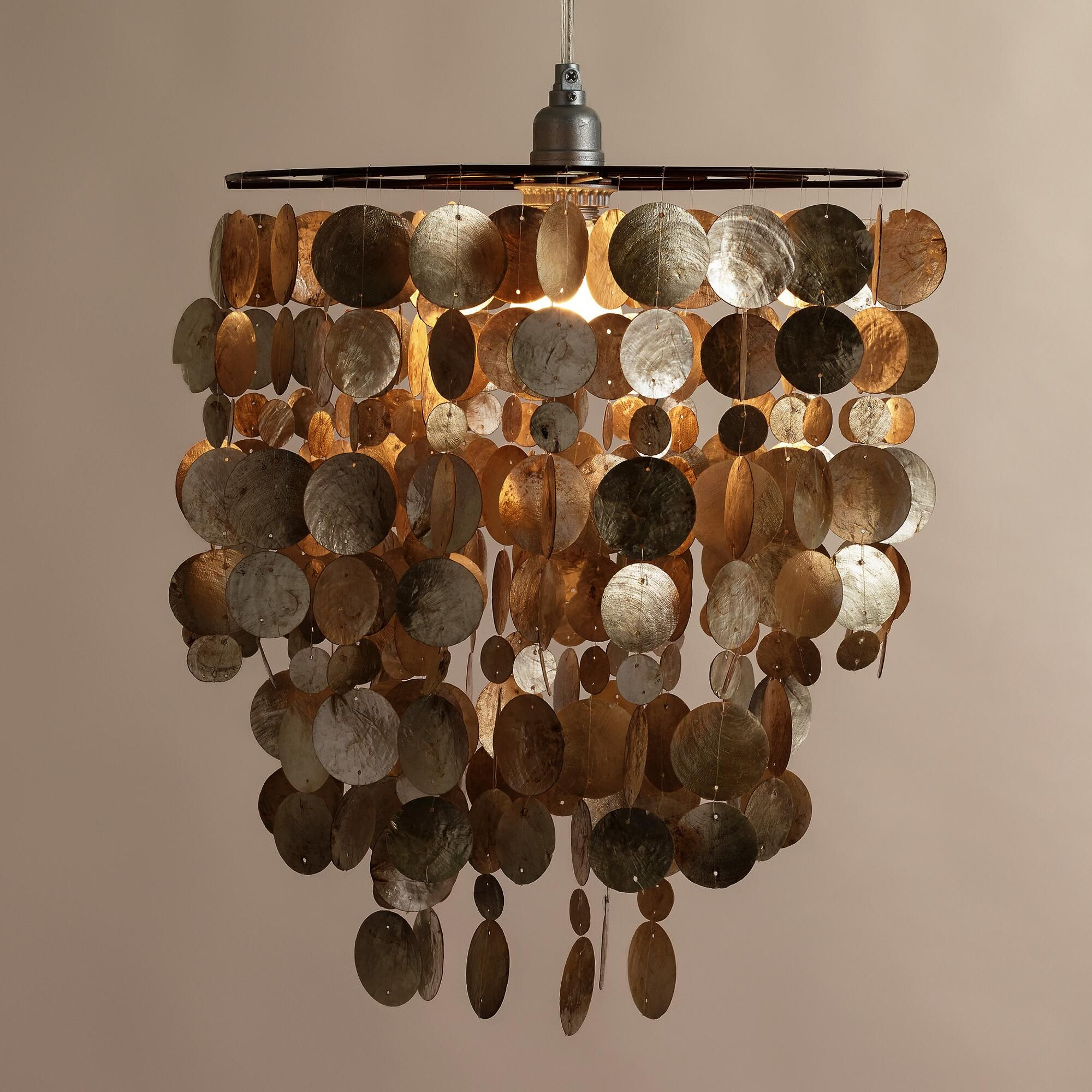 The dramatic ring of softly iridescent shells on our capiz hanging the dramatic ring of softly iridescent shells on our capiz hanging pendant lantern creates a soothing mozeypictures Image collections