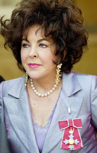 Elizabeth: Dame Commander of the British Empire, 2000 by Andrew Garth, via Flickr.Wearing her earrings she designed for the ceremony, having them crafted by Van Cleef and Aprels.
