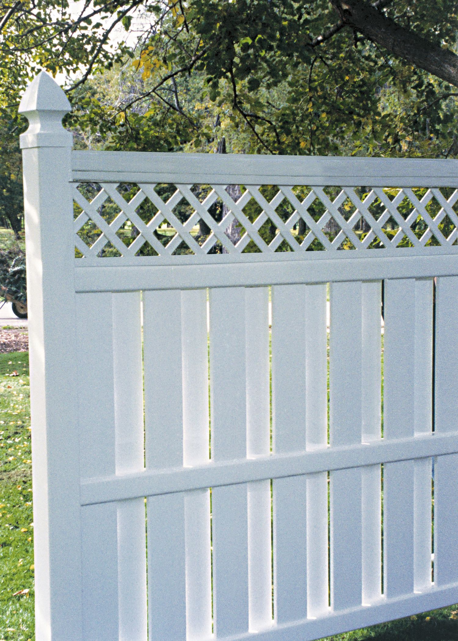 This closeup of Bufftech Columbia vinyl fence with lattice accent