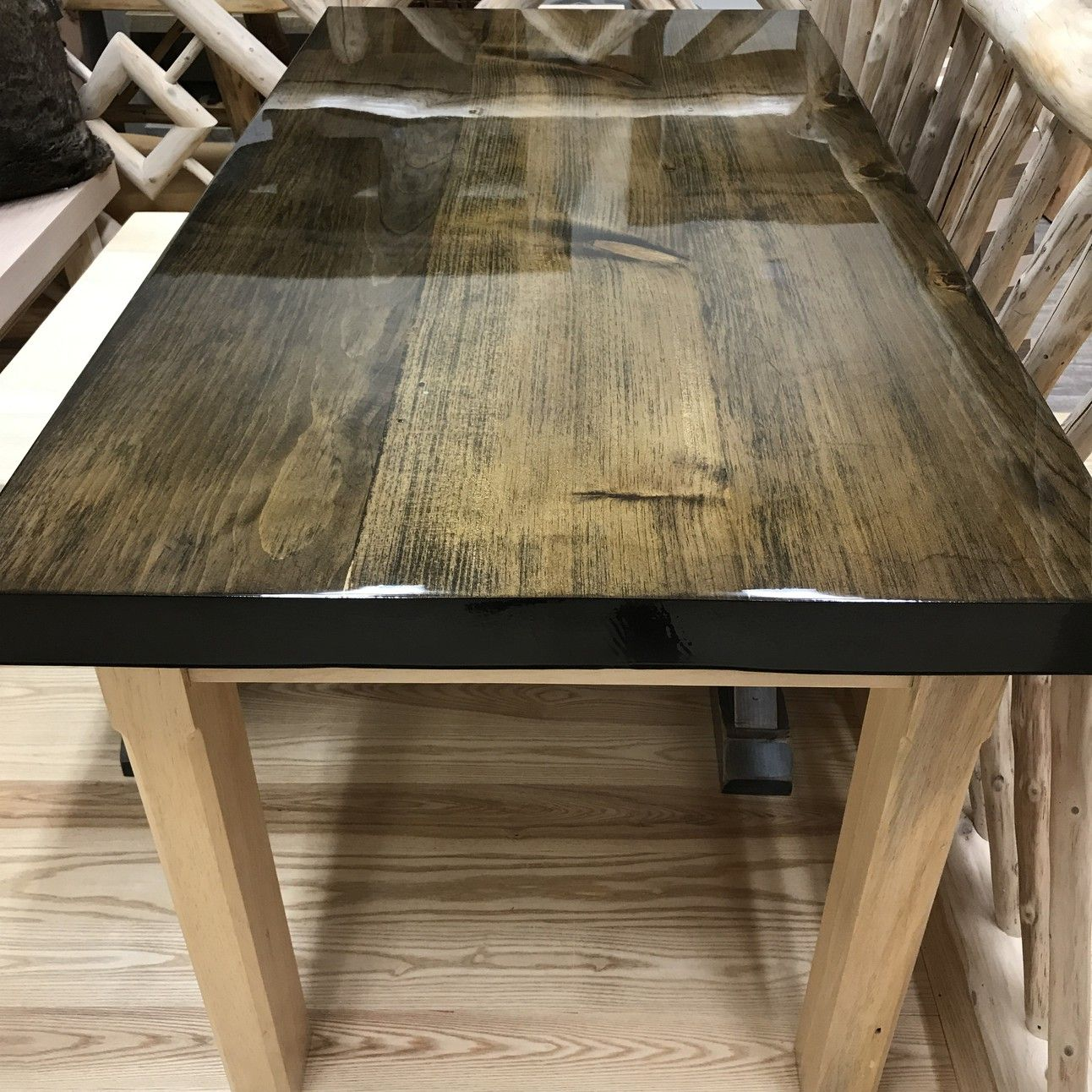 e462845d8e180 Pine slab dining table with liquid glass finish