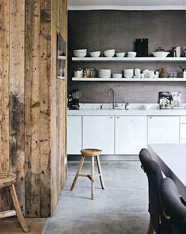 Love the reclaimed wood wall!!