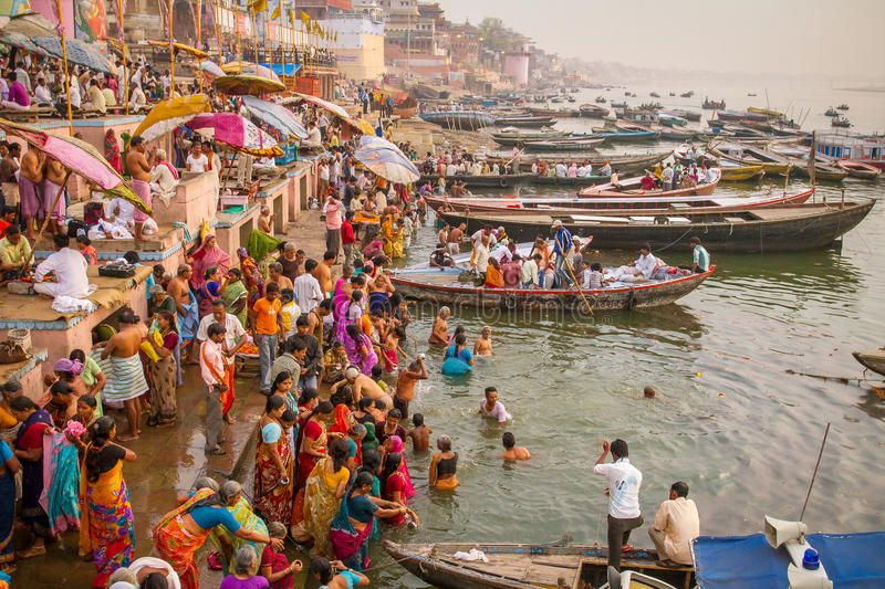 Boats and people on the ghats of Ganges river. VARANASI, INDIA - MARCH 21, 2013: ,
