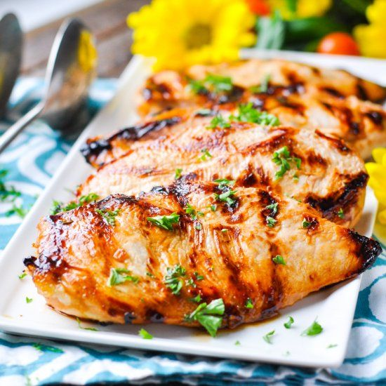 """Whether you grill, pan fry, or broil the meat, this juicy """"NO WORK"""" MARINATED CHICKEN is a healthy dinner that's ready in just 10 minutes!"""