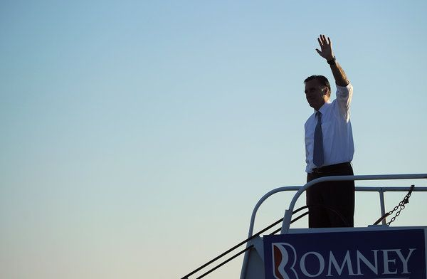 ann romney plane | Mitt Romney waves to supporters while boarding his campaign plane in ...