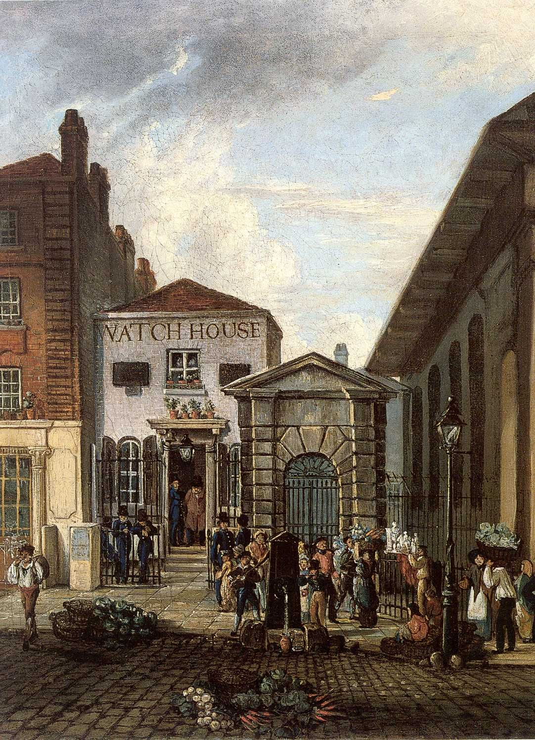 Covent Garden watch house, located next to the church of St. Paul Covent Garden.  A two storey white building with 'Watch House' painted on its upper floor is shown with a lively street scene in the foreground