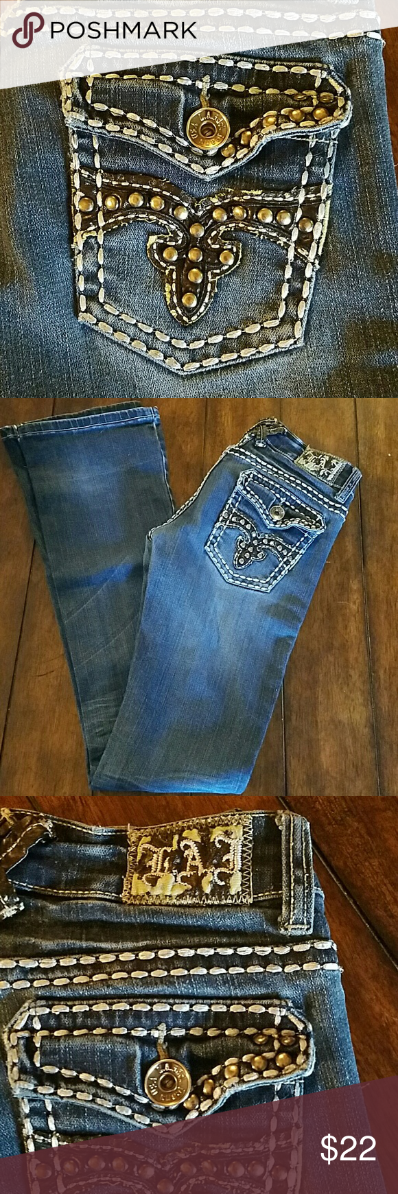 LA Idol jeans Worn a bit, but still really great condition. I just grew out of them. No rips or stains other than some pealing on the tag on the back (shown in picture 3). Thick stitching and brown leather with studs on back pockets LA Idol Jeans Boot Cut