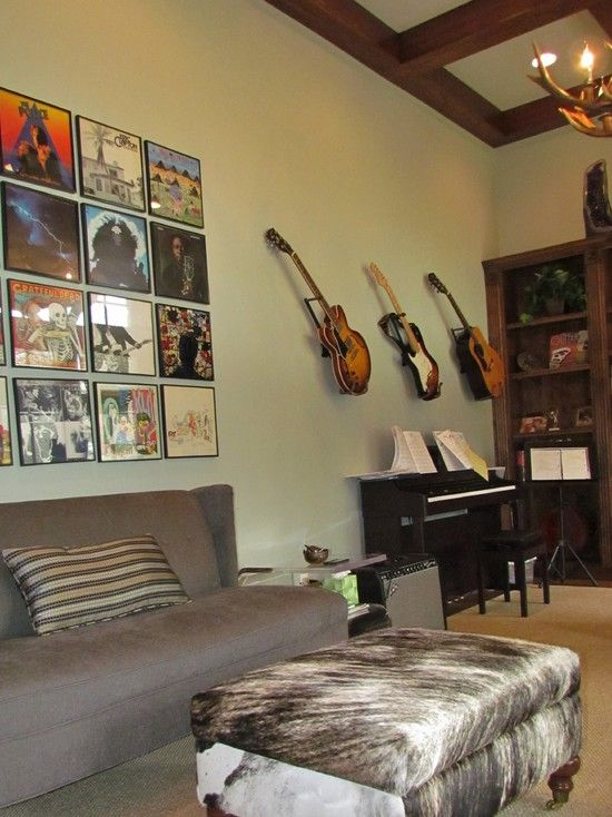 love the cow hide ottoman, album cover wall art and