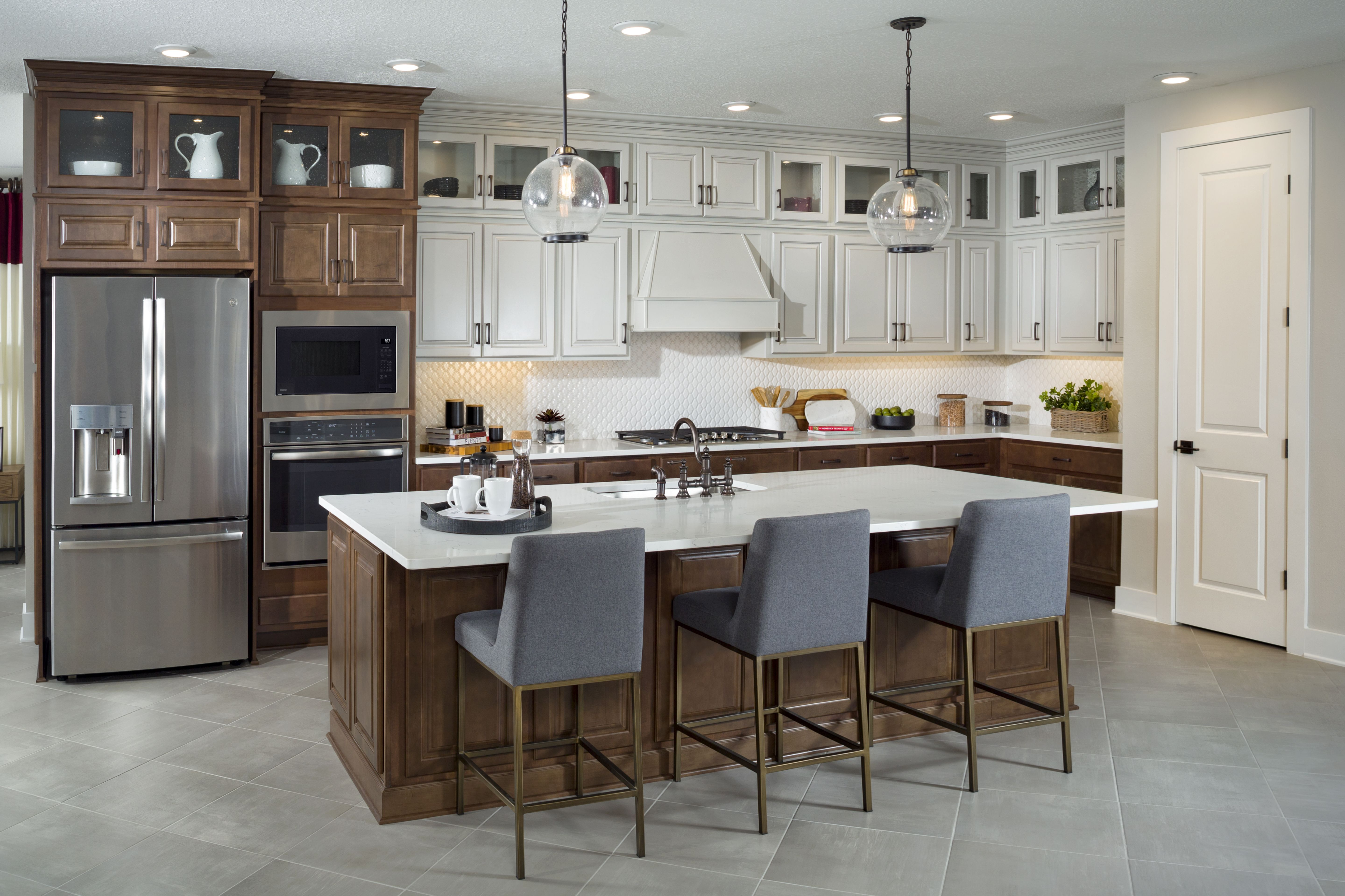 Make Your Kitchen Stand Out By Using Contrasting Dark And White Cabinets Brown Cabinets Home Kitchen Design
