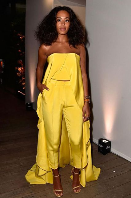 The holidays don't have to be the time to play it safe. Let your fashion freak flag fly: Choose a summer hue and a silhouette that's both dance-floor-ready and has a train. In other words, channel Solange, seen here in a Christian Siriano look with an IWC watch and Stuart Weitzman heels. Or, ya know, just always channel Solange.