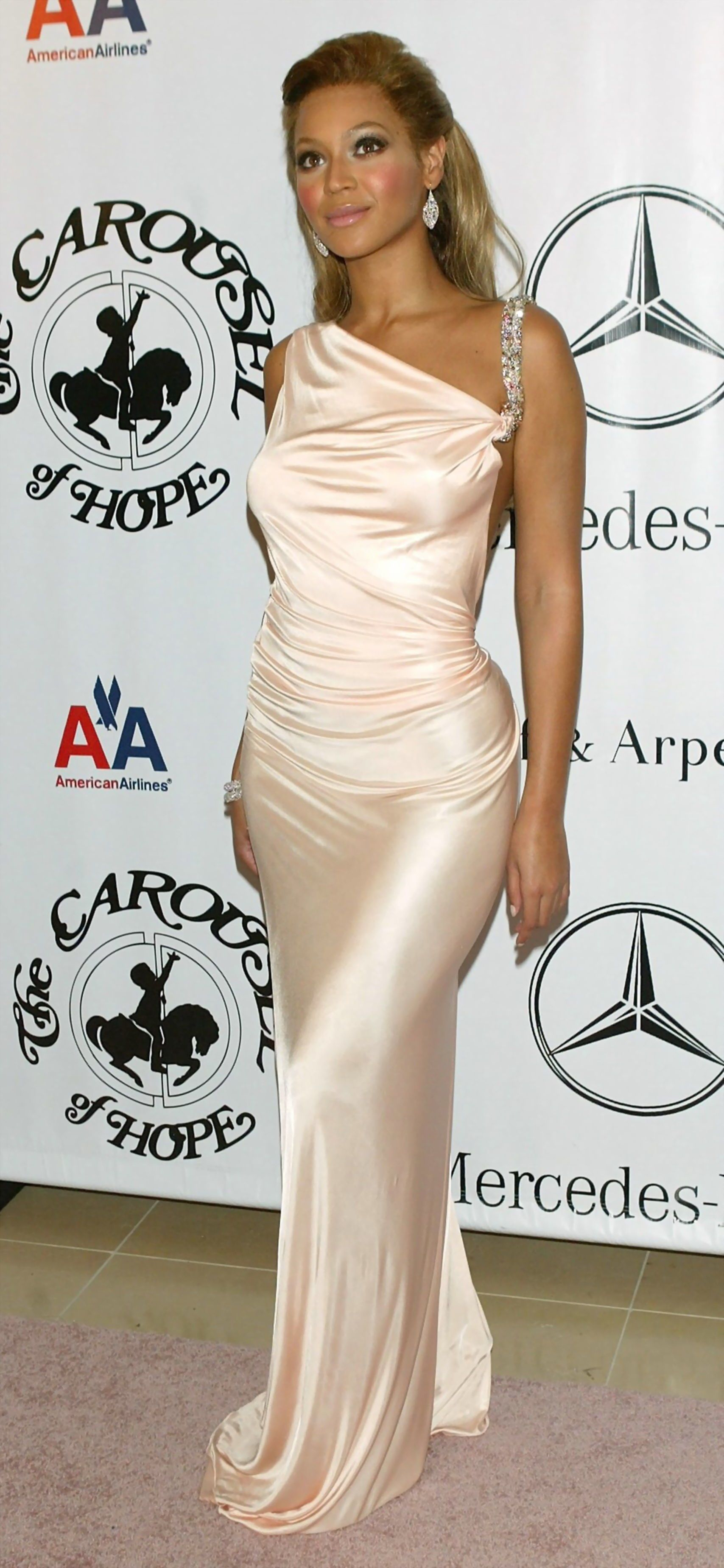 7d93f890fbd3 Beyonce in long satin dress at a charity ball