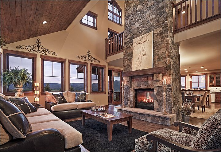 Great room with vaulted ceiling room features a gas for Vaulted living room