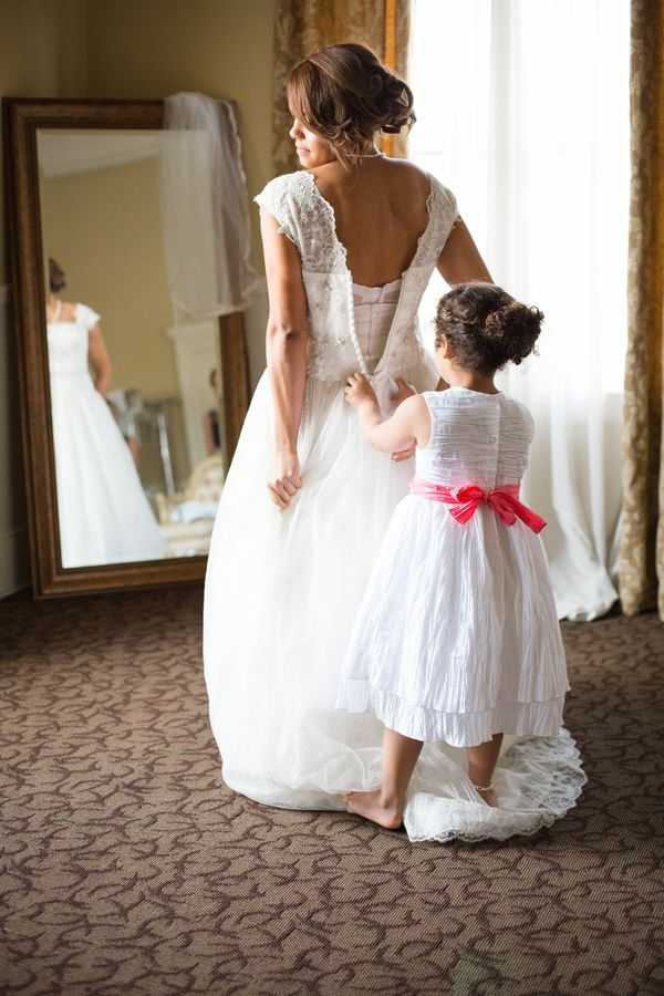 Ali Hormann Photography www.alihormann.com  The flower girl giving the bride some last minute help getting ready! Our Bride's Room is the perfect spot to capture pre-ceremony moments like this one.