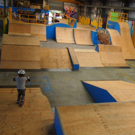 The Bunker Indoor Skate Park has a party room and would suit children aged 4+ (up to any age really).