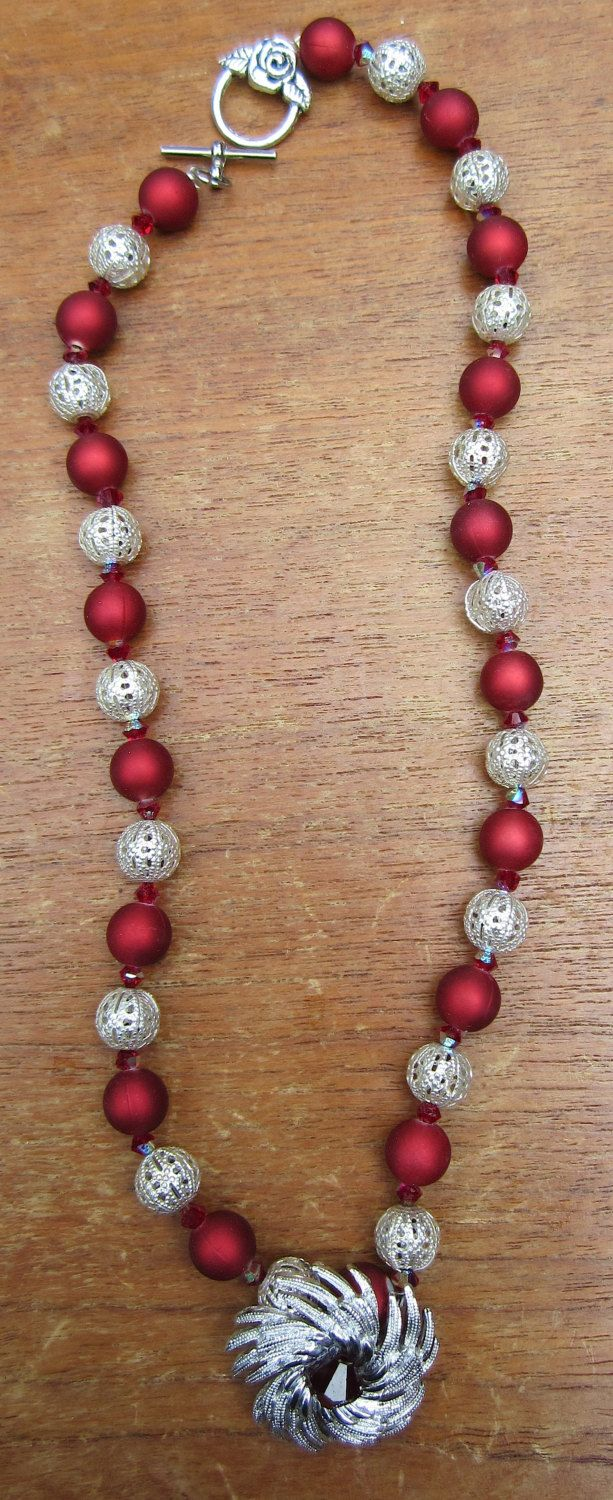 Ruby Colored Frosted Beads and Crystals Necklace with Mid Century Inspired Pendant. $16.00, via Etsy.