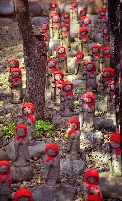 Jizo statues in Kamakura, Japan. Jizo take care of the souls of unborn children and those who died at a young age