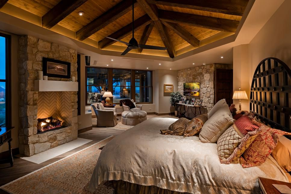 Cozy Master Bedroom With Fireplace And Exposed Beam Ceiling Luxury Bedroom Master Dream Master Bedroom Luxurious Bedrooms