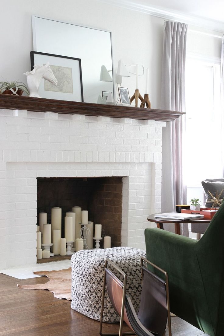 Fireplace Candles fill an unusable fireplace with different sized candles and