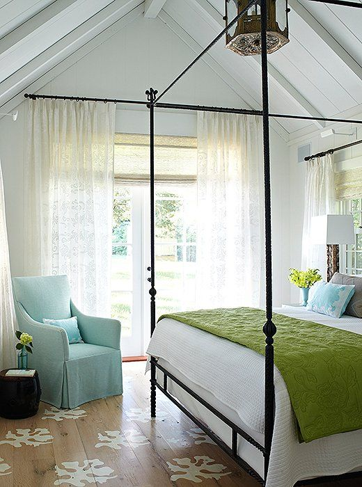 A dreamy white textile base with iron frame furniture provides the perfect place to add pops of turquoise and lime green in the bedroom.