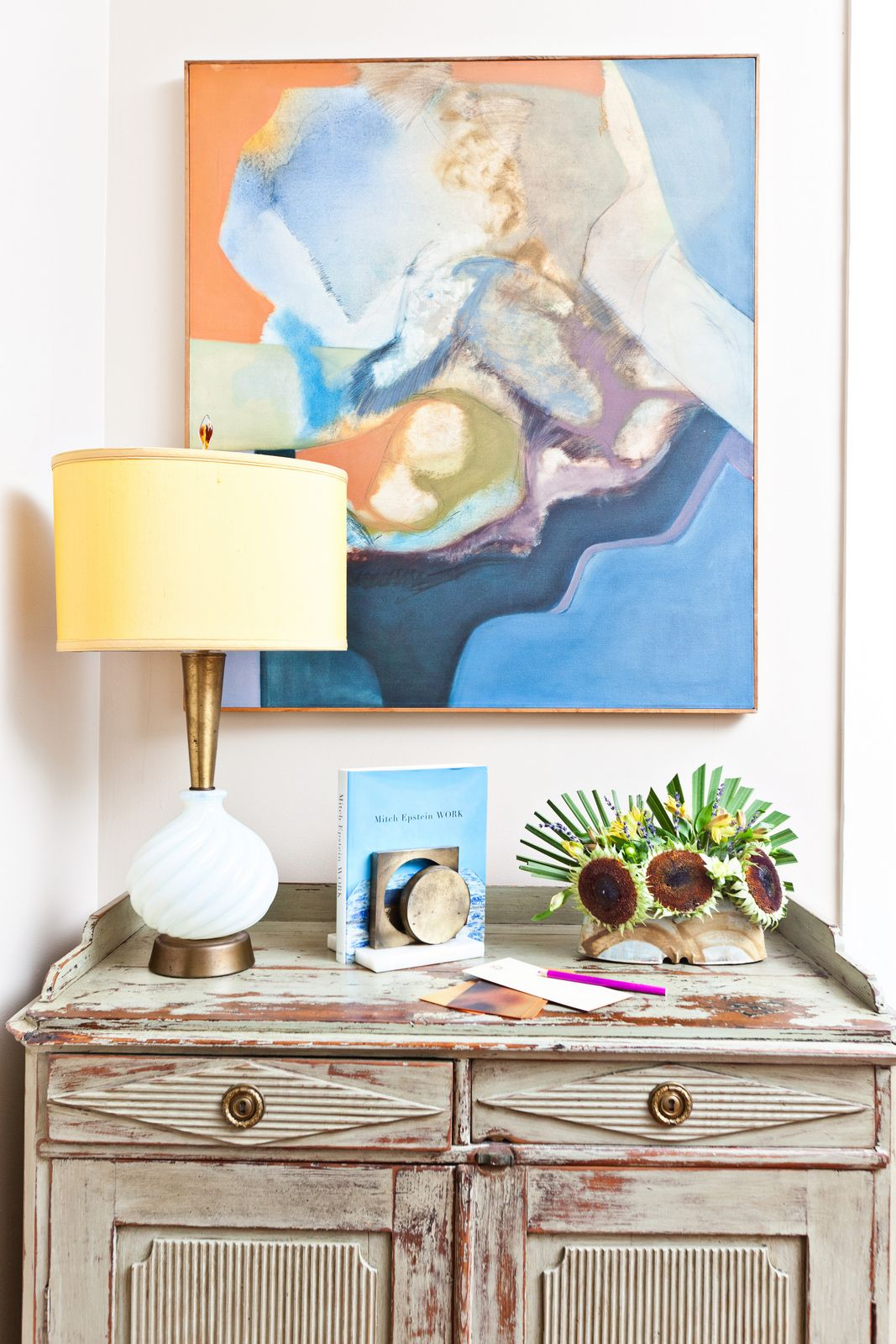 Abstract art above rustic console house of fifty so stylish