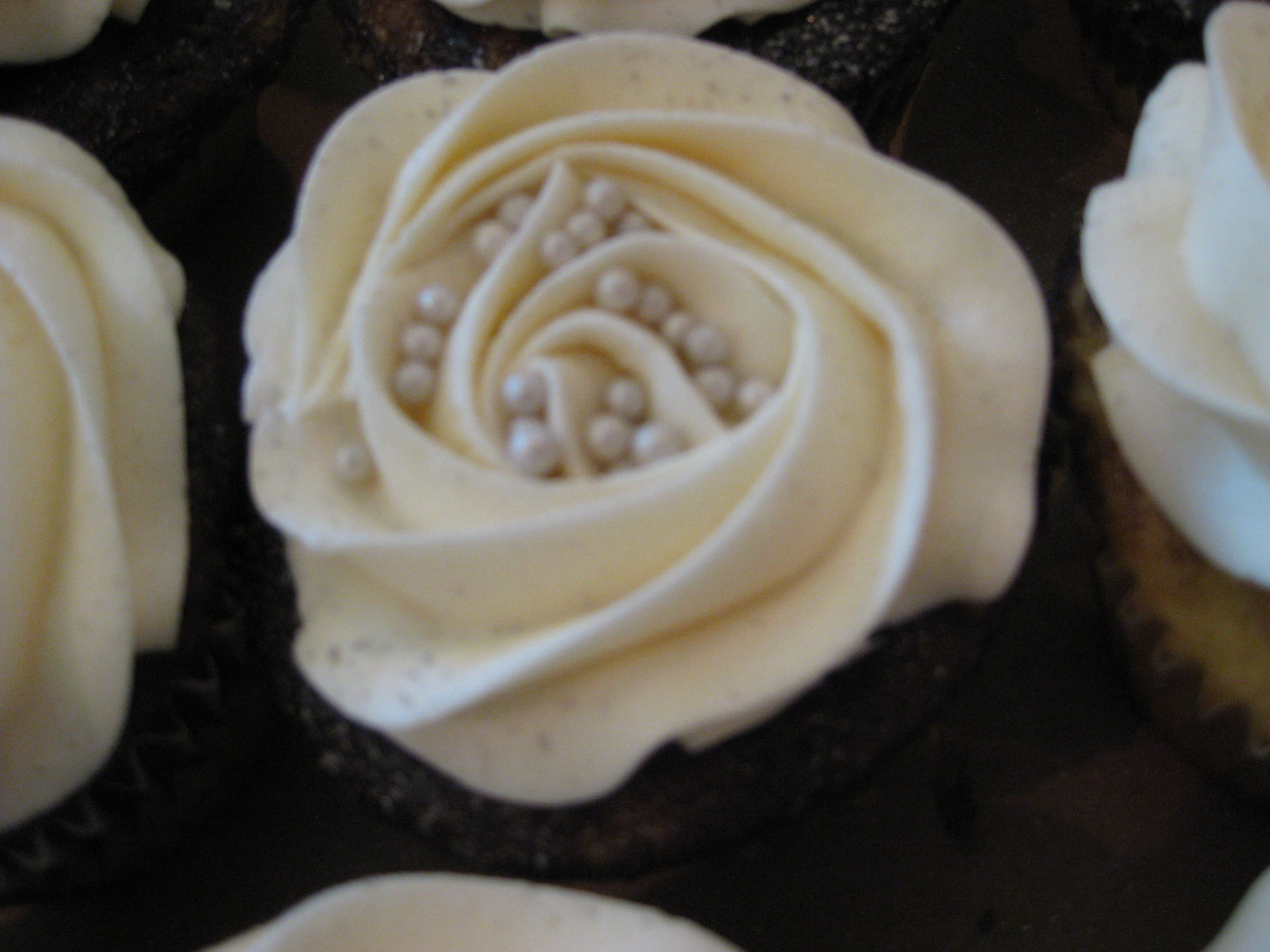Chocolate cupcake with butter creme rose and silver pearls