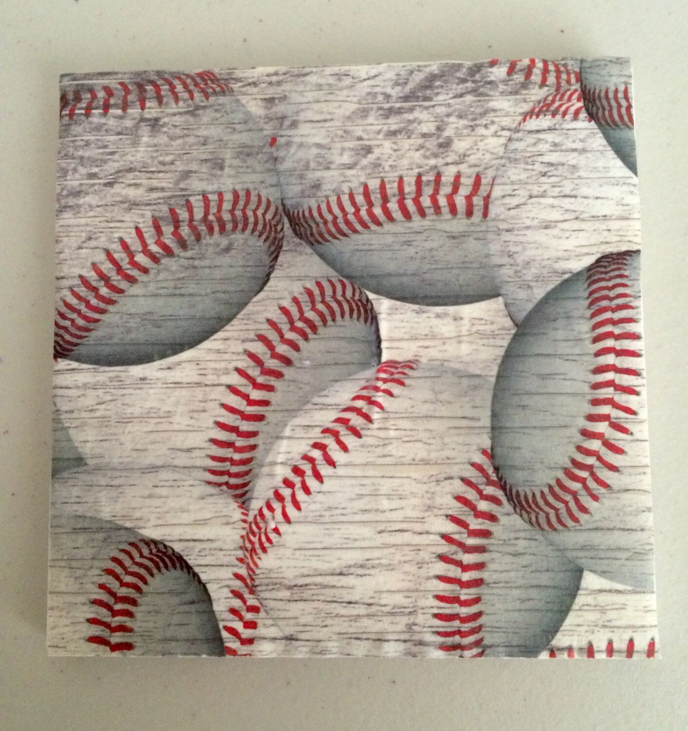 A personal favorite from my Etsy shop https://www.etsy.com/listing/273276456/baseball-decorative-tilecoaster