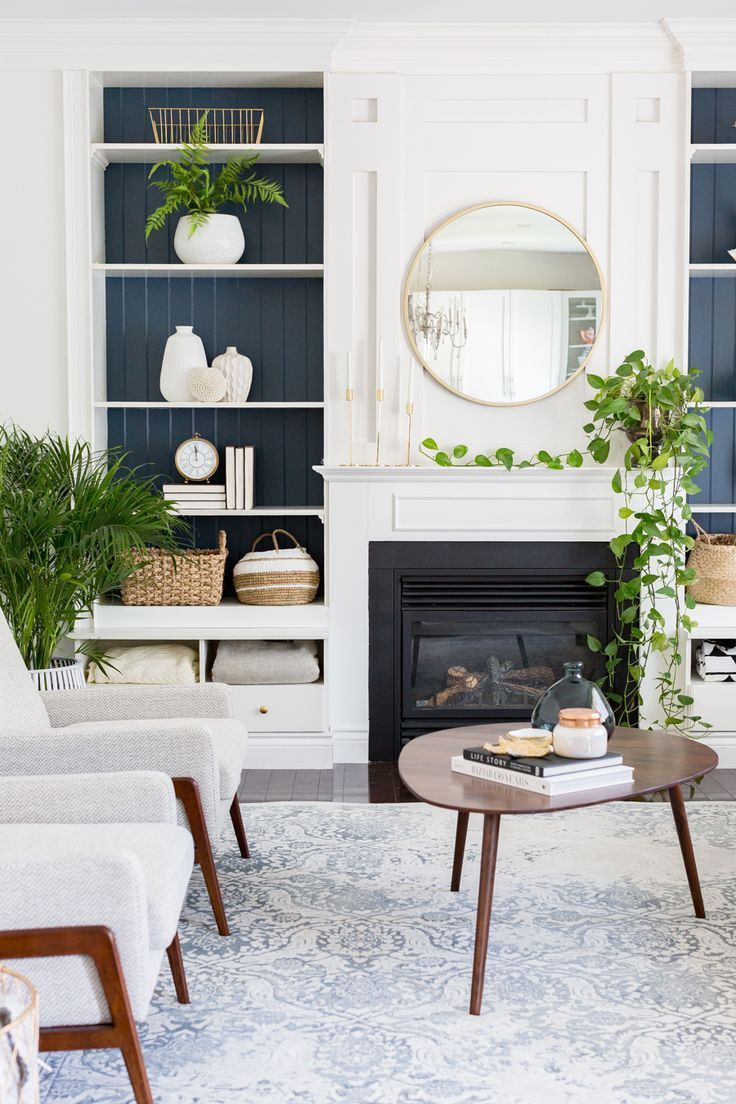 blue painted shelves in the family room with images on colors for farmhouse living room id=15900