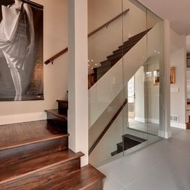 Contemporary Staircase by Stunning glass wall really opens up this space!  www.franksglass.com