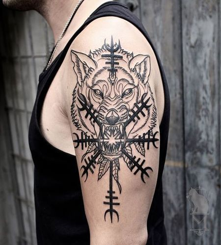 Image of  norse Wolf tattoo and helm of awe