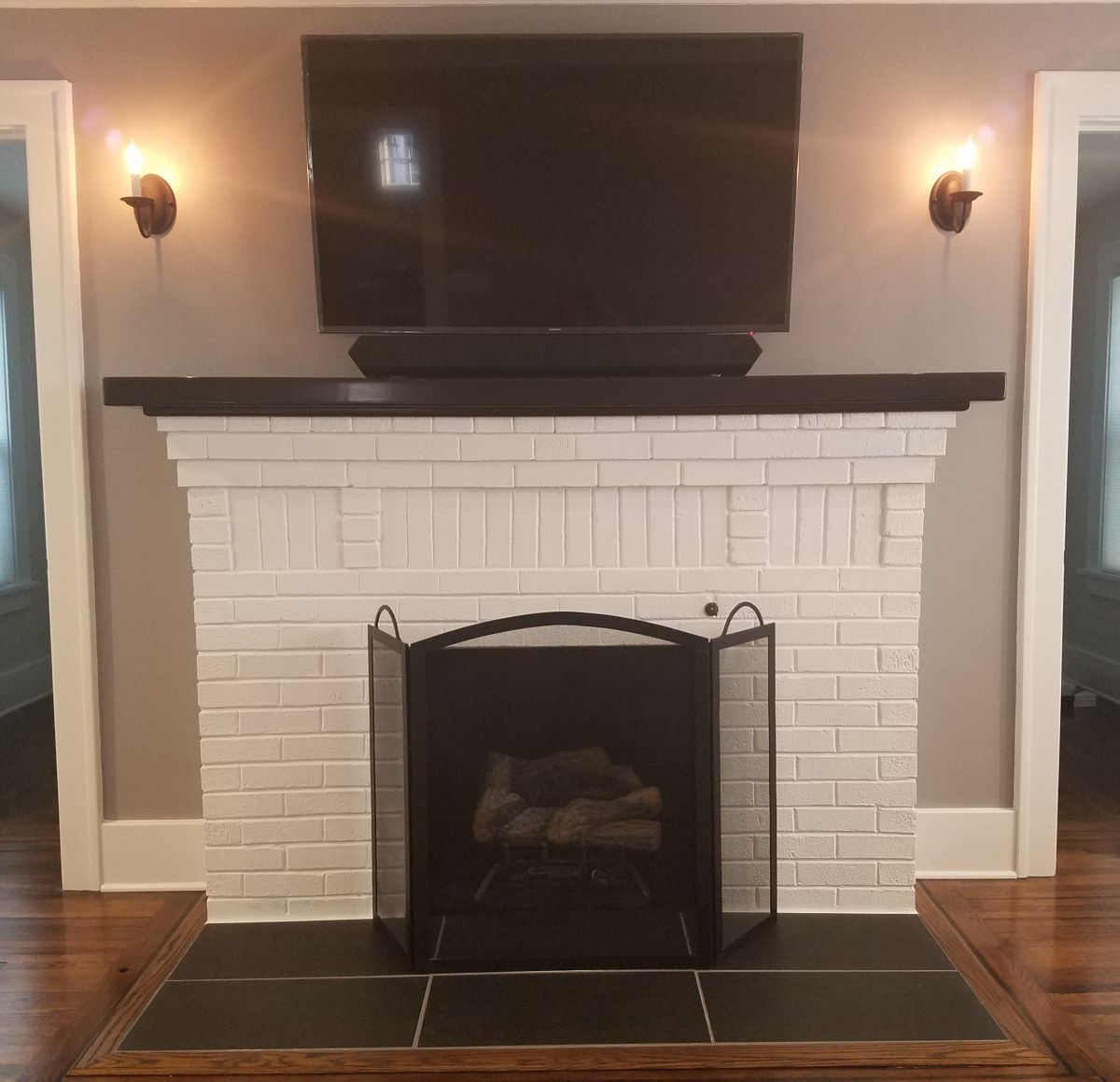 Refinished Fireplace White With Black Tile Hearth Lighting On Either Side Tv Above