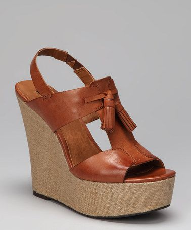 Take a look at this Cognac Brynne T-Strap Slingback Wedge by Calvin Klein on #zulily today! $59.00, regular 109.00. PRODUCT DESCRIPTION: A classic T-strap silhouette with a comfy elastic slingback crafted out of rich burnished leather sits atop a chunky fabric-covered wedge for a wow-worthy look packed with polished style.   5'' heel with 1.75'' platform Leather upper Man-made sole Imported