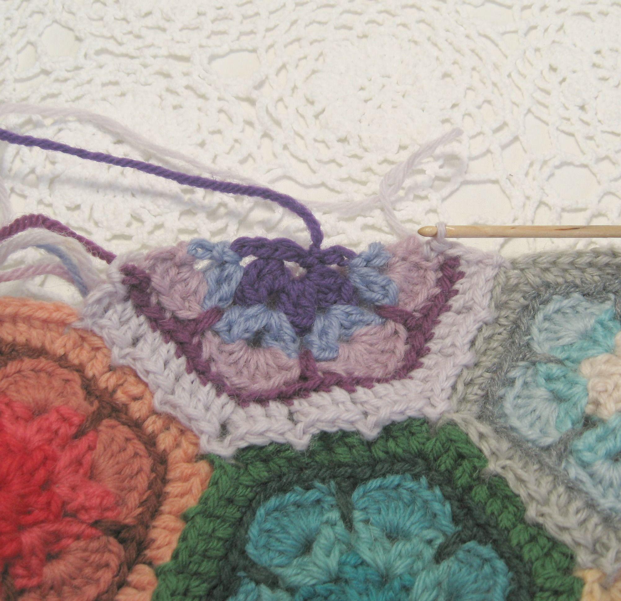 single crochet along the raw edge of the half hexagon ...