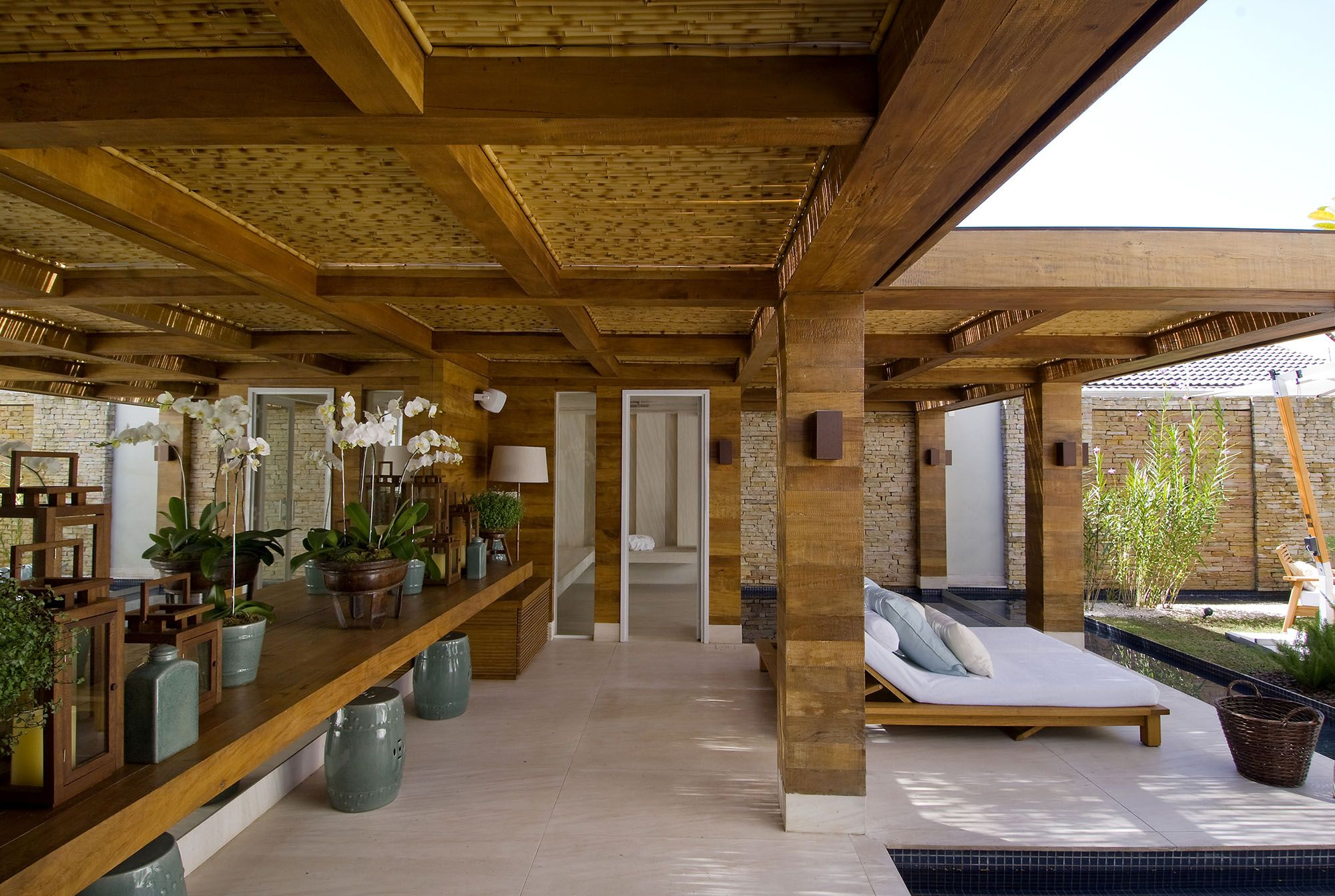 Bamboo panel ceiling in a home in Brazil designed by Debora Aguiar Arquitetos